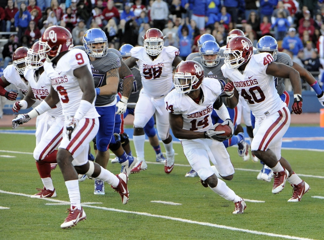 Oct 19, 2013; Lawrence, KS, USA; Oklahoma Sooners defensive back Aaron Colvin (14) recovers a blocked extra point attempt against the Kansas Jayhawks in the second half at Memorial Stadium. Oklahoma won the game 34-19. Mandatory Credit: John Rieger-USA TODAY Sports
