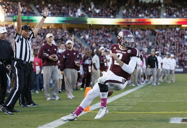 Oct 19, 2013; College Station, TX, USA; Texas A&M Aggies quarterback Johnny Manziel (2) scores a 1-yard touchdown run against the Auburn Tigers during the second half at Kyle Field. Mandatory Credit: Soobum Im-USA TODAY Sports