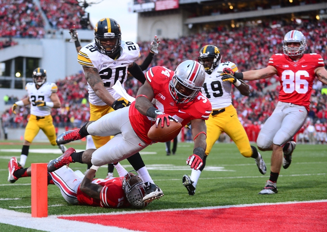 Oct 19, 2013; Columbus, OH, USA; Ohio State Buckeyes running back Carlos Hyde (34) dives into the end zone for a touchdown during the fourth quarter against the Iowa Hawkeyes at Ohio Stadium. Mandatory Credit: Andrew Weber-USA TODAY Sports