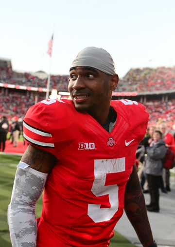 Oct 19, 2013; Columbus, OH, USA; Ohio State Buckeyes quarterback Braxton Miller (5) walks off the field after defeating Iowa Hawkeyes 34-24 at Ohio Stadium. Mandatory Credit: Andrew Weber-USA TODAY Sports