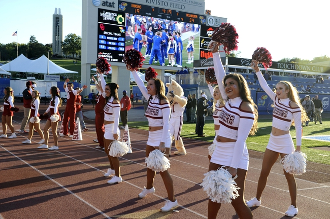 Oct 19, 2013; Lawrence, KS, USA; Oklahoma Sooners cheerleaders perform after a touchdown against the Kansas Jayhawks in the second half at Memorial Stadium. Oklahoma won the game 34-19. Mandatory Credit: John Rieger-USA TODAY Sports