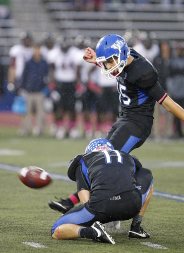 Oct 19, 2013; Buffalo, NY, USA; Buffalo Bulls kicker Patrick Clarke (45) kicks a field goal during the second half against the Massachusetts Minutemen at University of Buffalo Stadium. Buffalo beats Massachusetts 32 to 3.  Mandatory Credit: Timothy T. Ludwig-USA TODAY Sports