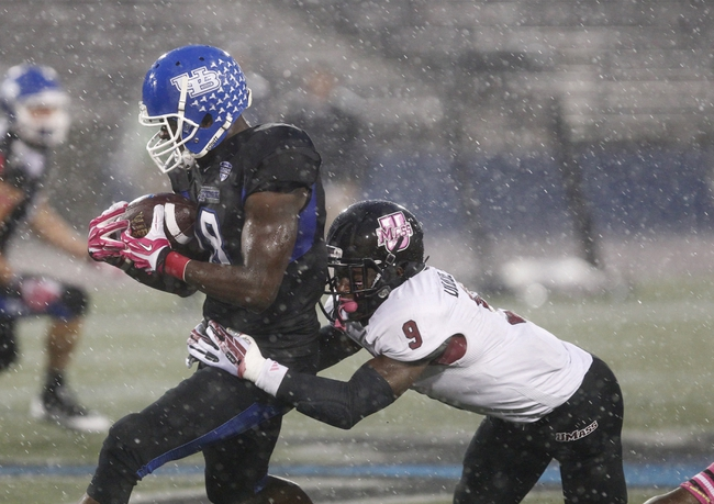 Oct 19, 2013; Buffalo, NY, USA; Buffalo Bulls wide receiver Fred Lee (18) catches the ball and gets tackled by Massachusetts Minutemen defensive back Trey Dudley-Giles (9) during the second half at University of Buffalo Stadium. Buffalo beats Massachusetts 32 to 3.  Mandatory Credit: Timothy T. Ludwig-USA TODAY Sports