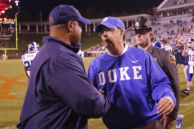 Oct 19, 2013; Charlottesville, VA, USA;  Duke Blue Devils head coach David Cutcliffe shakes hands with Virginia Cavaliers head coach Mike London after their game at Scott Stadium. The Blue Devils won 35-22. Mandatory Credit: Geoff Burke-USA TODAY Sports