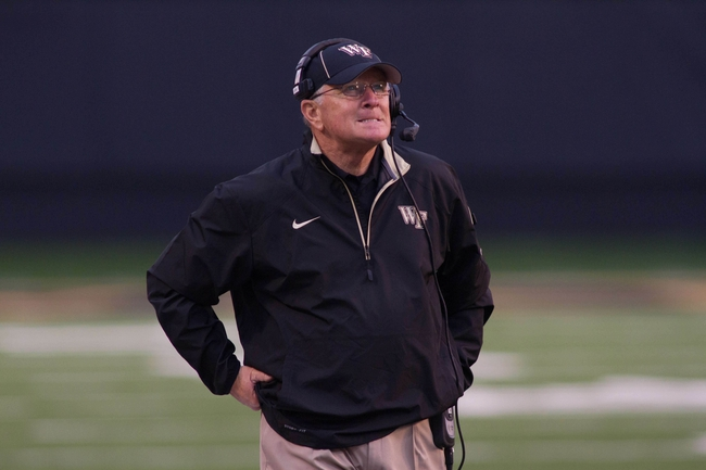 Oct 19, 2013; Winston-Salem, NC, USA; Wake Forest Demon Deacons head coach Jim Grobe watches a replay during the fourth quarter against the Maryland Terrapins at BB&T Field. Wake defeated Maryland 34-10. Mandatory Credit: Jeremy Brevard-USA TODAY Sports