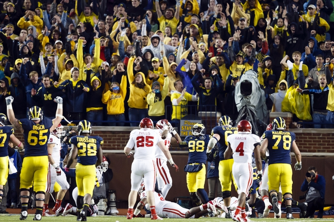 Oct 19, 2013; Ann Arbor, MI, USA; Michigan Wolverines quarterback Devin Gardner (98) celebrates his touchdown in the fourth quarter against the Indiana Hoosiers at Michigan Stadium. Michigan won 63-47. Mandatory Credit: Rick Osentoski-USA TODAY Sports