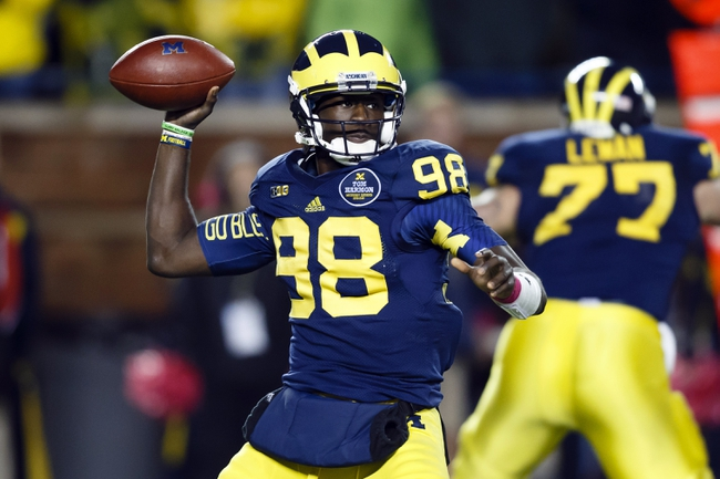 Oct 19, 2013; Ann Arbor, MI, USA; Michigan Wolverines quarterback Devin Gardner (98) passes the ball in the fourth quarter against the Indiana Hoosiers at Michigan Stadium. Michigan won 63-47. Mandatory Credit: Rick Osentoski-USA TODAY Sports