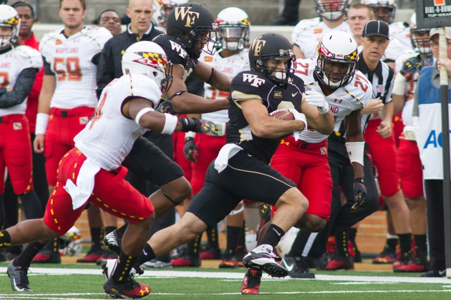 Oct 19, 2013; Winston-Salem, NC, USA; Wake Forest Demon Deacons wide receiver Michael Campanaro (3) runs through Maryland Terrapins defenders during the third quarter at BB&T Field. Wake defeated Maryland 34-10. Mandatory Credit: Jeremy Brevard-USA TODAY Sports