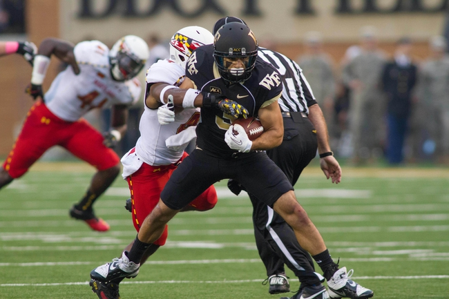 Oct 19, 2013; Winston-Salem, NC, USA; Wake Forest Demon Deacons wide receiver Michael Campanaro (3) runs after catching a pass during the third quarter against the Maryland Terrapins at BB&T Field. Wake defeated Maryland 34-10. Mandatory Credit: Jeremy Brevard-USA TODAY Sports