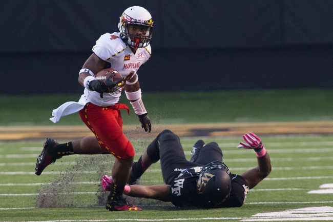 Oct 19, 2013; Winston-Salem, NC, USA; Maryland Terrapins defensive back William Likely (4) runs by Wake Forest Demon Deacons defensive end Desmond Floyd (94) during the fourth quarter at BB&T Field. Wake defeated Maryland 34-10. Mandatory Credit: Jeremy Brevard-USA TODAY Sports