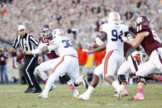 Oct 19, 2013; College Station, TX, USA; Auburn Tigers defensive end Dee Ford (30) pressures Texas A&M Aggies quarterback Johnny Manziel (2) during the second half at Kyle Field. Tigers won 45-41. Mandatory Credit: Soobum Im-USA TODAY Sports