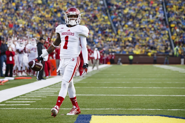 Oct 19, 2013; Ann Arbor, MI, USA; Indiana Hoosiers wide receiver Shane Wynn (1) walks the ball in for a touch down in the third quarter against the Michigan Wolverines at Michigan Stadium. Mandatory Credit: Rick Osentoski-USA TODAY Sports