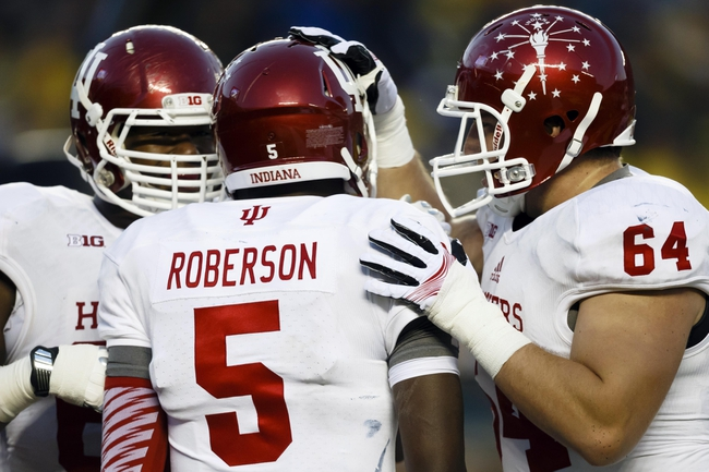 Oct 19, 2013; Ann Arbor, MI, USA; Indiana Hoosiers quarterback Tre Roberson (5) receives congratulations from center Collin Rahrig (64) after scoring a touchdown in the second half against the Michigan Wolverines at Michigan Stadium. Mandatory Credit: Rick Osentoski-USA TODAY Sports
