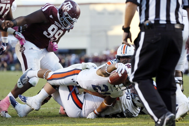Oct 19, 2013; College Station, TX, USA; Auburn Tigers running back Tre Mason (21) scores a 2-yard touchdown run against the Texas A&M Aggies during the second half at Kyle Field. Tigers won 45-41. Mandatory Credit: Soobum Im-USA TODAY Sports