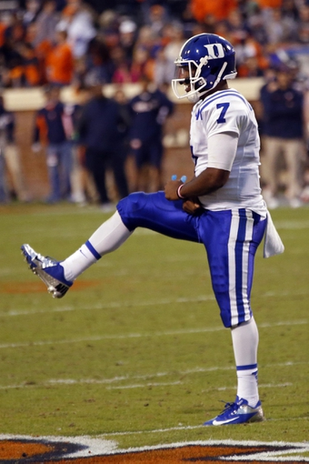 Oct 19, 2013; Charlottesville, VA, USA;  Duke Blue Devils quarterback Anthony Boone (7) celebrates after throwing a touchdown pass against the Virginia Cavaliers in the fourth quarter at Scott Stadium. The Blue Devils won 35-22. Mandatory Credit: Geoff Burke-USA TODAY Sports