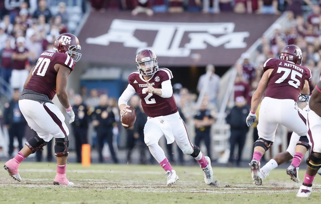 Oct 19, 2013; College Station, TX, USA; Texas A&M Aggies quarterback Johnny Manziel (2) runs with the ball against the Auburn Tigers during the second half at Kyle Field. Tigers won 45-41. Mandatory Credit: Soobum Im-USA TODAY Sports