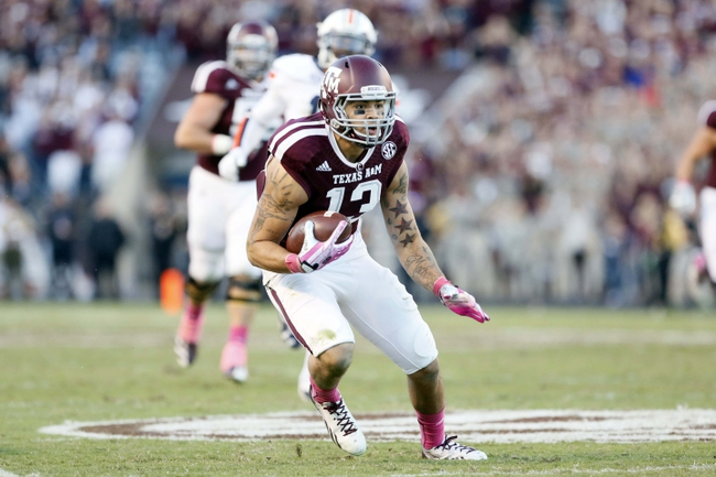 Oct 19, 2013; College Station, TX, USA; Texas A&M Aggies wide receiver Mike Evans (13) looks to run after making a catch against the Auburn Tigers during the second half at Kyle Field. Tigers won 45-41. Mandatory Credit: Soobum Im-USA TODAY Sports