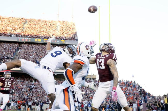 Oct 19, 2013; College Station, TX, USA; Texas A&M Aggies wide receiver Mike Evans (13) is unable to make the catch as Auburn Tigers defensive back Jermaine Whitehead (9) defends the play during the second half at Kyle Field. Tigers won 45-41. Mandatory Credit: Soobum Im-USA TODAY Sports