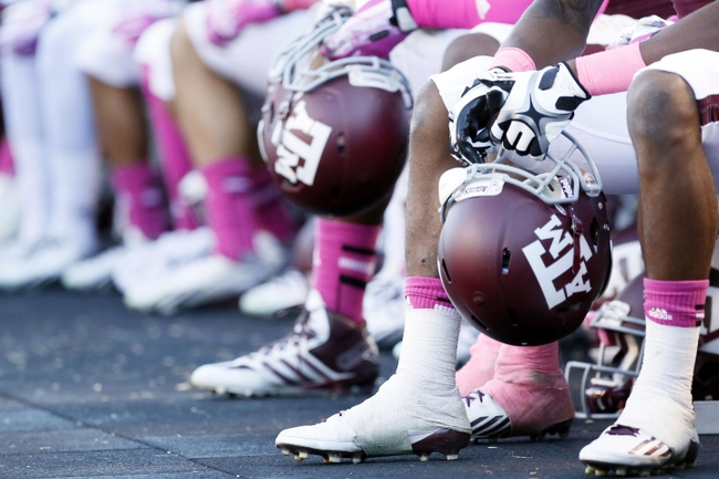 Oct 19, 2013; College Station, TX, USA; Detail of the shoes and spats of Texas A&M Aggies players during a game against the Auburn Tigers at Kyle Field. Mandatory Credit: Soobum Im-USA TODAY Sports