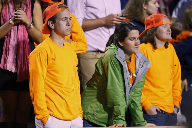 Oct 19, 2013; Charlottesville, VA, USA;  Virginia Cavaliers fans watch from the stands in the fourth quarter against the Duke Blue Devils at Scott Stadium. The Blue Devils won 35-22. Mandatory Credit: Geoff Burke-USA TODAY Sports