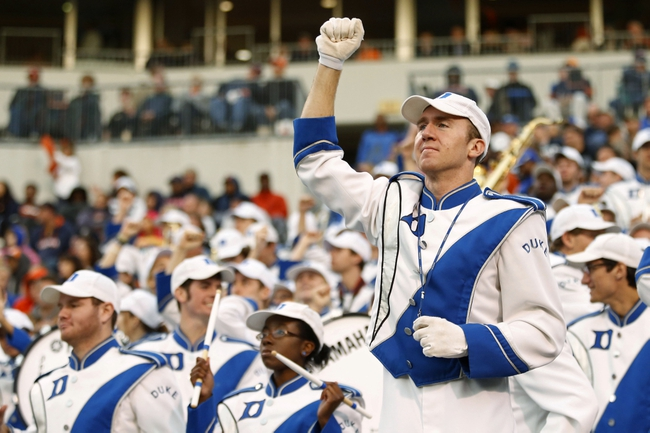 Oct 19, 2013; Charlottesville, VA, USA;  Members of the Duke Blue Devils band cheer from the stands against the Virginia Cavaliers in the fourth quarter at Scott Stadium. The Blue Devils won 35-22. Mandatory Credit: Geoff Burke-USA TODAY Sports