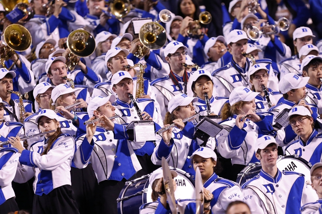 Oct 19, 2013; Charlottesville, VA, USA;  The Duke Blue Devils band performs in the stands against the Virginia Cavaliers in the fourth quarter at Scott Stadium. The Blue Devils won 35-22. Mandatory Credit: Geoff Burke-USA TODAY Sports