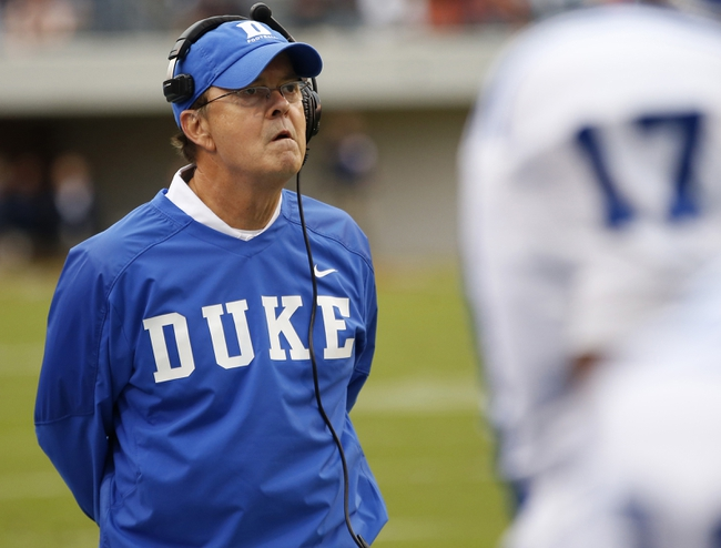 Oct 19, 2013; Charlottesville, VA, USA;  Duke Blue Devils head coach David Cutcliffe watches form the sidelines against the Virginia Cavaliers in the second quarter at Scott Stadium. The Blue Devils won 35-22. Mandatory Credit: Geoff Burke-USA TODAY Sports