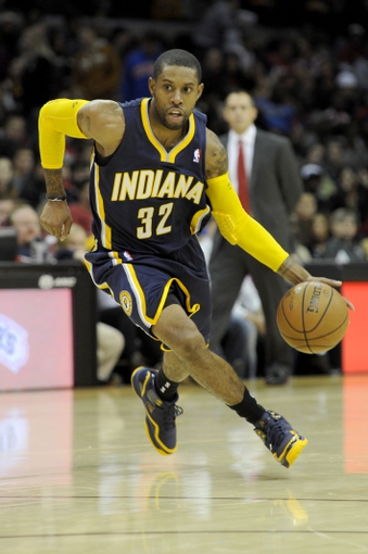 Oct 19, 2013; Cleveland, OH, USA; Indiana Pacers guard C.J. Watson (32) brings the ball up the court during the second quarter against the Cleveland Cavaliers at Quicken Loans Arena. Mandatory Credit: Ken Blaze-USA TODAY Sports