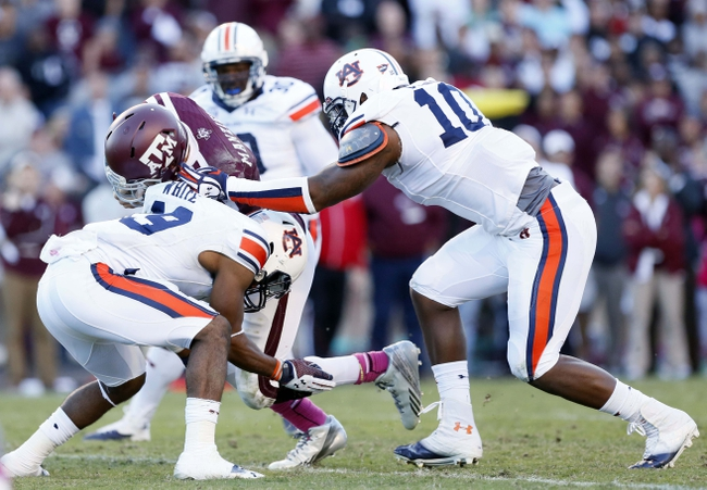 Oct 19, 2013; College Station, TX, USA; Texas A&M Aggies quarterback Johnny Manziel (2) is tackled by Auburn Tigers defensive back Ryan White (left) during the second half at Kyle Field. Mandatory Credit: Soobum Im-USA TODAY Sports