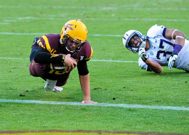 Oct 19, 2013; Tempe, AZ, USA; Arizona State Sun Devils quarterback Taylor Kelly (10) is downed at the 1 yard line during the second half as Washington Huskies linebacker Princeton Fuimaono (37) looks on at Sun Devil Stadium. Mandatory Credit: Matt Kartozian-USA TODAY Sports