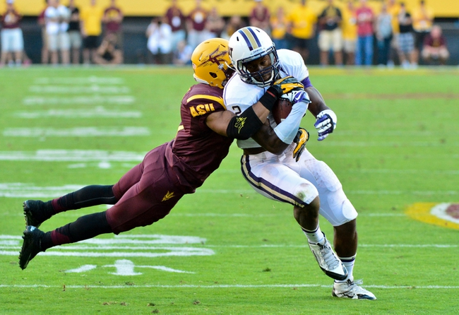 Oct 19, 2013; Tempe, AZ, USA; Arizona State Sun Devils defensive back Lloyd Carrington (17) tackles Washington Huskies wide receiver Kasen Williams (2) during the second half at Sun Devil Stadium. Mandatory Credit: Matt Kartozian-USA TODAY Sports