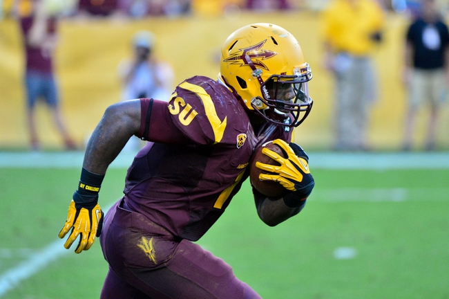 Oct 19, 2013; Tempe, AZ, USA; Arizona State Sun Devils running back Marion Grice (1) returns a kickoff during the second half against the Washington Huskies at Sun Devil Stadium. Mandatory Credit: Matt Kartozian-USA TODAY Sports