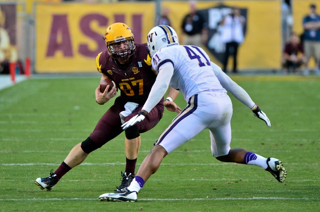 Oct 19, 2013; Tempe, AZ, USA; Arizona State Sun Devils tight end Chris Coyle (87) runs with the ball as Washington Huskies linebacker Travis Feeney (41) defends during the second half at Sun Devil Stadium. Mandatory Credit: Matt Kartozian-USA TODAY Sports