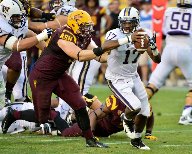 Oct 19, 2013; Tempe, AZ, USA; Arizona State Sun Devils defensive end Gannon Conway (95) sacks Washington Huskies quarterback Keith Price (17) during the second half at Sun Devil Stadium. Mandatory Credit: Matt Kartozian-USA TODAY Sports