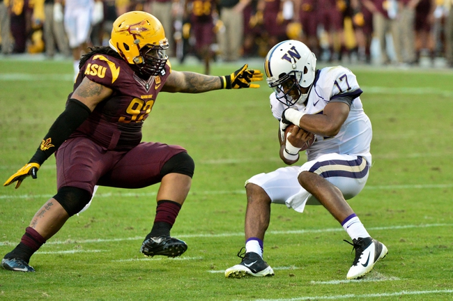 Oct 19, 2013; Tempe, AZ, USA; Arizona State Sun Devils defensive lineman Jaxon Hood (92) sacks Washington Huskies quarterback Keith Price (17) during the second half at Sun Devil Stadium. Mandatory Credit: Matt Kartozian-USA TODAY Sports