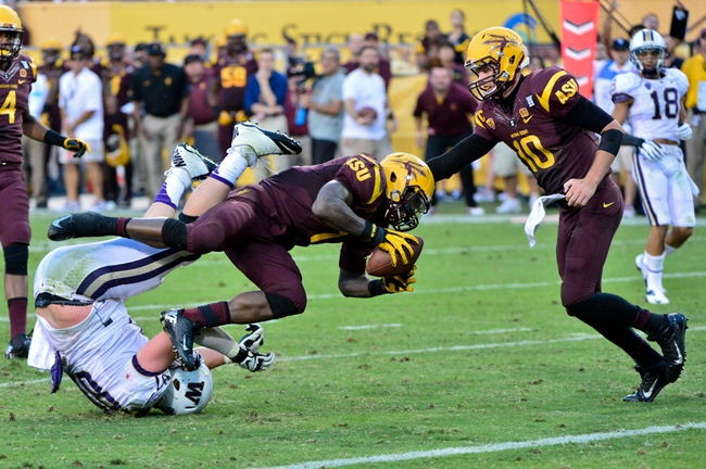 Oct 19, 2013; Tempe, AZ, USA; Arizona State Sun Devils running back Marion Grice (1) dives towards the endzone as quarterback Taylor Kelly (10) watches and Washington Huskies defensive end Evan Hudson (80) tumbles during the second half at Sun Devil Stadium. Mandatory Credit: Matt Kartozian-USA TODAY Sports
