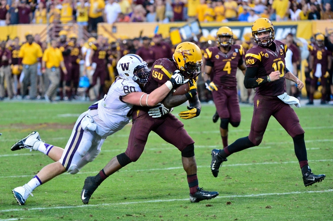 Oct 19, 2013; Tempe, AZ, USA; Arizona State Sun Devils running back Marion Grice (1) breaks a tackle from Washington Huskies defensive end Evan Hudson (80) during the second half at Sun Devil Stadium. Mandatory Credit: Matt Kartozian-USA TODAY Sports