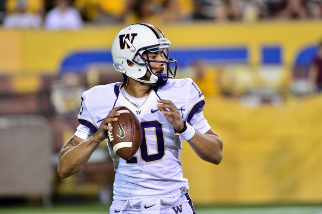 Oct 19, 2013; Tempe, AZ, USA; Washington Huskies quarterback Cyler Miles (10) looks to pass during the second half against the Arizona State Sun Devils at Sun Devil Stadium. Mandatory Credit: Matt Kartozian-USA TODAY Sports