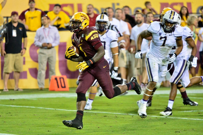Oct 19, 2013; Tempe, AZ, USA; Arizona State Sun Devils running back Marion Grice (1) runs for a 14 yard touchdown as Washington Huskies chase during the second half at Sun Devil Stadium. Mandatory Credit: Matt Kartozian-USA TODAY Sports