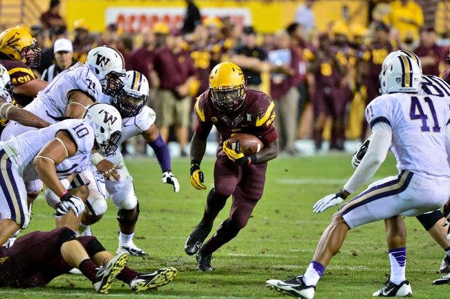 Oct 19, 2013; Tempe, AZ, USA; Arizona State Sun Devils running back Marion Grice (1) runs through Washington Huskies defenders during the second half at Sun Devil Stadium. Mandatory Credit: Matt Kartozian-USA TODAY Sports