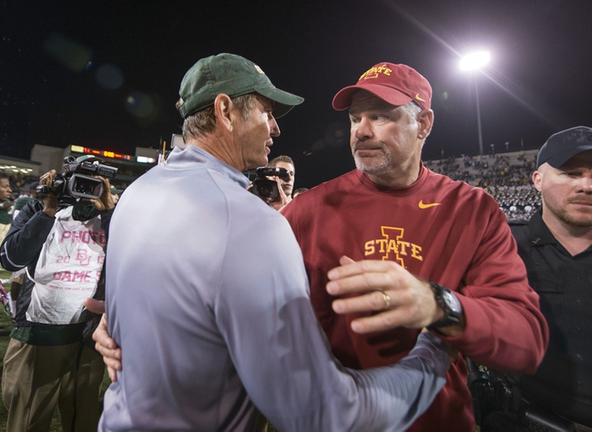 Oct 19, 2013; Waco, TX, USA; Baylor Bears head coach Art Briles and Iowa State Cyclones head coach Paul Rhoads meet at midfield after the game at Floyd Casey Stadium. The Bears defeated the Cyclones 71-7. Mandatory Credit: Jerome Miron-USA TODAY Sports