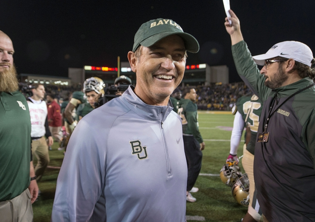 Oct 19, 2013; Waco, TX, USA; Baylor Bears head coach Art Briles celebrates the win over the Iowa State Cyclones at Floyd Casey Stadium. The Bears defeated the Cyclones 71-7. Mandatory Credit: Jerome Miron-USA TODAY Sports