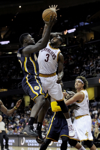 Oct 19, 2013; Cleveland, OH, USA; Indiana Pacers guard Lance Stephenson (1) drives against Cleveland Cavaliers guard Dion Waiters (3) during the third quarter at Quicken Loans Arena. The Pacers beat the Cavaliers 102-79. Mandatory Credit: Ken Blaze-USA TODAY Sports