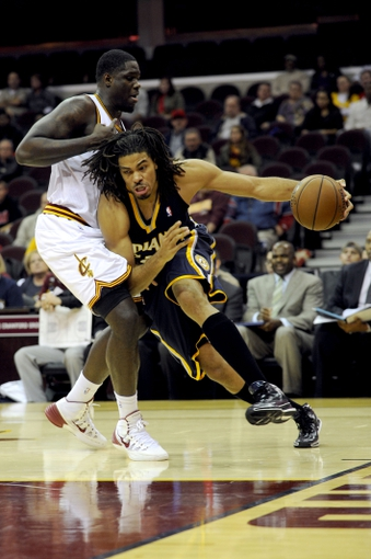 Oct 19, 2013; Cleveland, OH, USA; Indiana Pacers forward Chris Copeland (22) drives on Cleveland Cavaliers forward Anthony Bennett (15) during the fourth quarter at Quicken Loans Arena. The Pacers beat the Cavaliers 102-79. Mandatory Credit: Ken Blaze-USA TODAY Sports