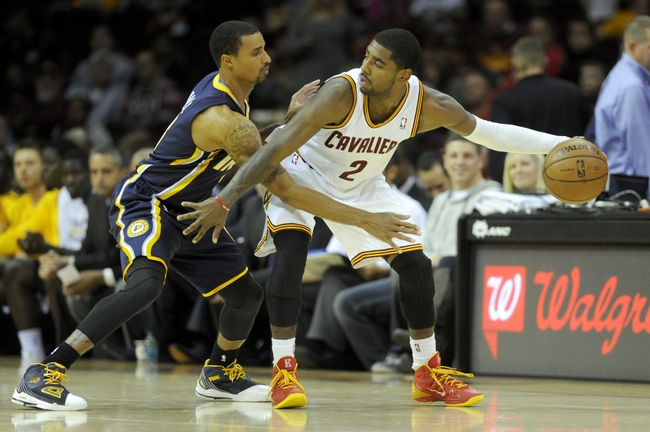 Oct 19, 2013; Cleveland, OH, USA; Indiana Pacers guard George Hill (3) defends Cleveland Cavaliers guard Kyrie Irving (2) during the third quarter at Quicken Loans Arena. The Pacers beat the Cavaliers 102-79. Mandatory Credit: Ken Blaze-USA TODAY Sports
