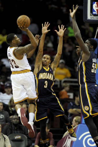 Oct 19, 2013; Cleveland, OH, USA; Cleveland Cavaliers guard Alonzo Gee (33) shoots on Indiana Pacers guard George Hill (3) and Indiana Pacers center Roy Hibbert (55) during the third quarter at Quicken Loans Arena. The Pacers beat the Cavaliers 102-79. Mandatory Credit: Ken Blaze-USA TODAY Sports