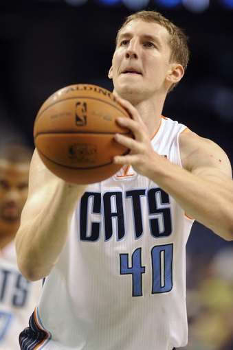 Oct 19, 2013; Greensboro, NC, USA; Charlotte Bobcats forward Cody Zeller (40) shoots the ball during the game against the Dallas Mavericks at Greensboro Coliseum. The Mavericks won 89-83. Mandatory Credit: Sam Sharpe-USA TODAY Sports
