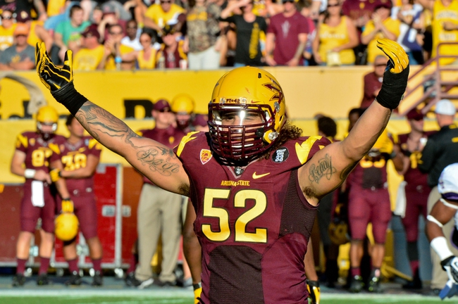 Oct 19, 2013; Tempe, AZ, USA; Arizona State Sun Devils linebacker Carl Bradford (52) signals to the crowd during the first half against the Washington Huskies at Sun Devil Stadium. Mandatory Credit: Matt Kartozian-USA TODAY Sports