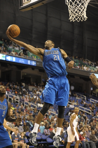Oct 19, 2013; Greensboro, NC, USA; Dallas Mavericks guard Wayne Ellington (21) grabs the rebound during the game against the Charlotte Bobcats at Greensboro Coliseum. The Mavericks won 89-83. Mandatory Credit: Sam Sharpe-USA TODAY Sports