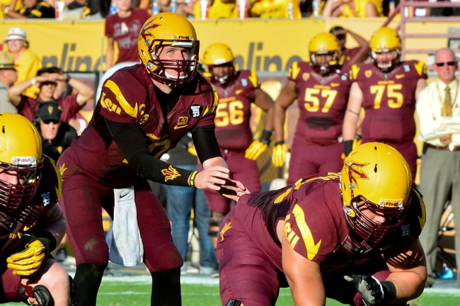 Oct 19, 2013; Tempe, AZ, USA; Arizona State Sun Devils quarterback Taylor Kelly (10) prepares to take the snap from center Kody Koebensky (67) during the first half against the Washington Huskies at Sun Devil Stadium. Mandatory Credit: Matt Kartozian-USA TODAY Sports